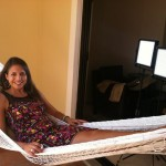Ashley lounging out on a hammock while filming Paradise Found