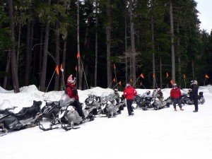 Snowmobilers breaking froms snowmobiling