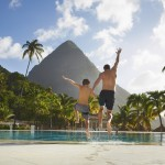 Family image - man and son jumping in pool