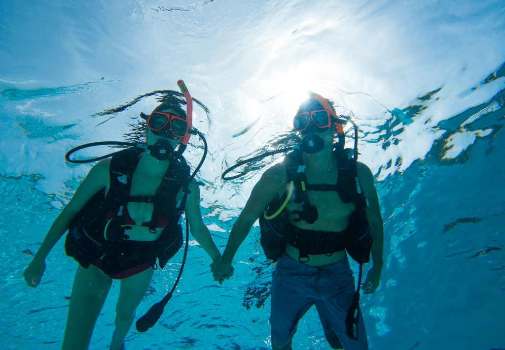 Dive into the waves and scuba dive with Sandals Resorts