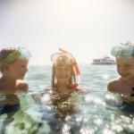 Kids having fun snorkeling in beautiful sea