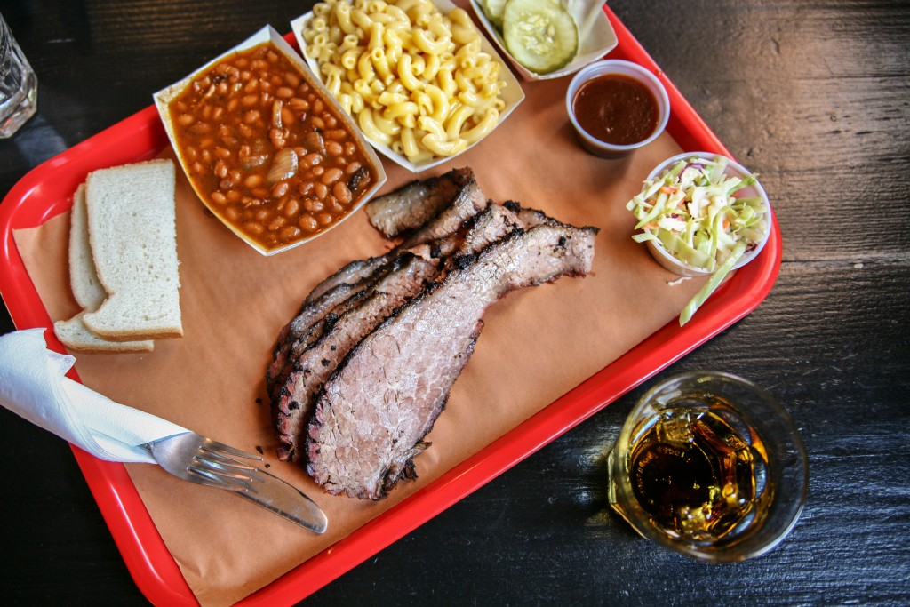 BBQ brisket, sides, and whiskey